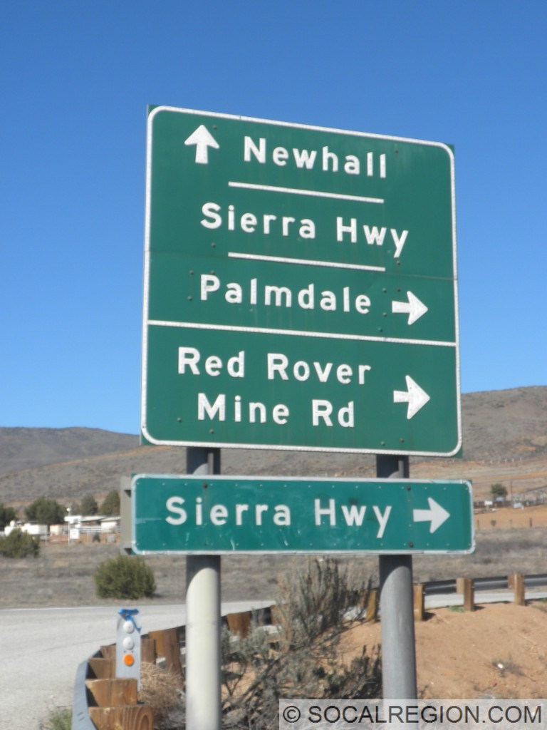 Signage at Ward Road. This dates to 1965, yet still refers traffic down Sierra Highway to Newhall.