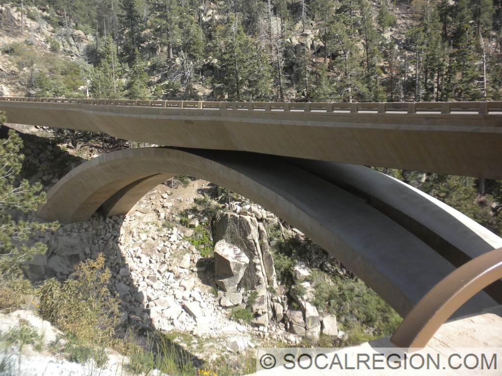 New concrete arch bridge in front of Big Bear Dam. Completed in 2011.