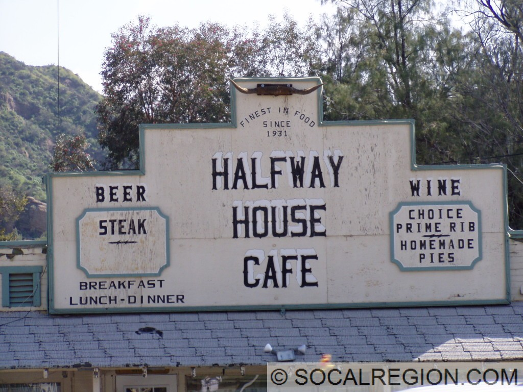 Sign on the Halfway House Cafe noting its age.