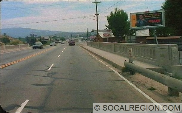 This bridge north of 11th St. was originally built with two lanes in 1922 and was widened to four lanes in 1935 as shown by the date on the railing. It was replaced by a wider bridge in 1996. The photo dates to 1993 and was taken from the Caltrans Photo Log. Photo Courtesy - CALTRANS.