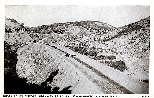 "Postcard view of 99 through the lake area. Chumash Island, as it is now known, is to the left. This was known as the ""Big Cut and Fill""."