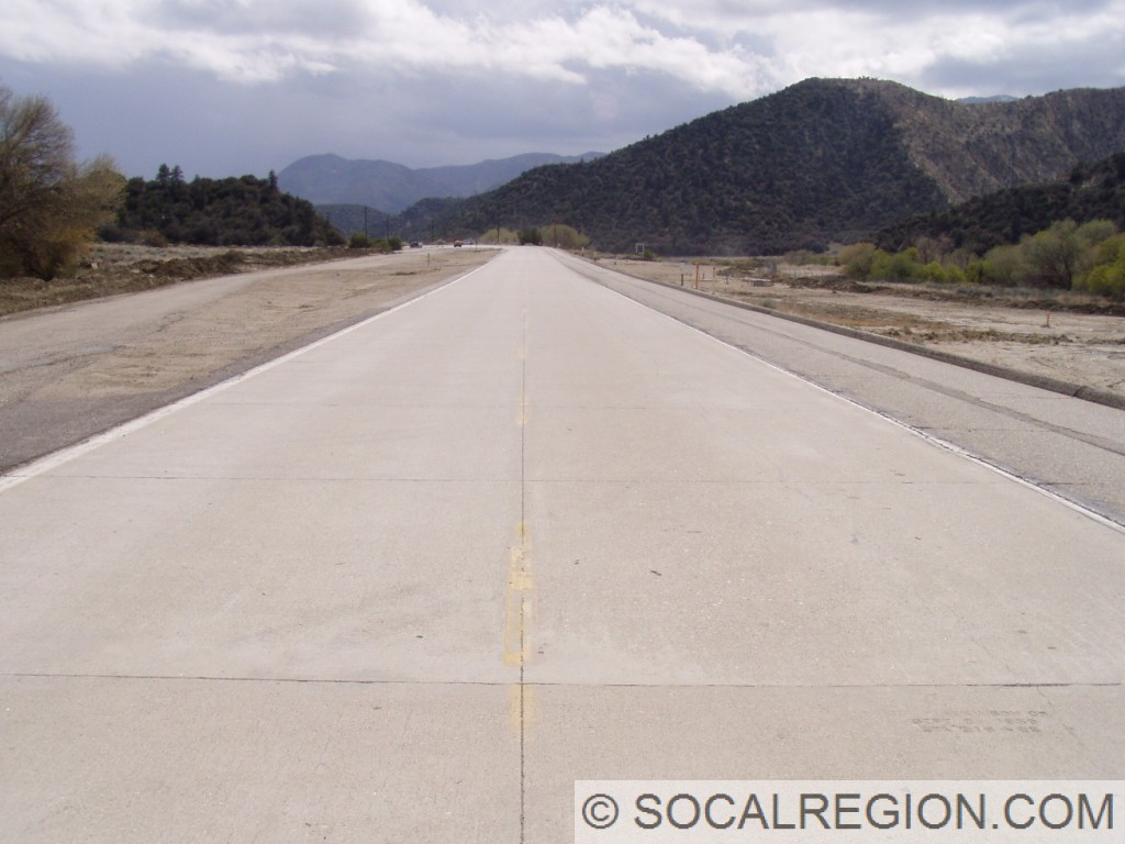 View of the 1959 concrete. Facing South. These lanes composed the southbound side of US 99. When the expressway was first built, these lanes were asphalt. In 1959, they were converted into concrete.