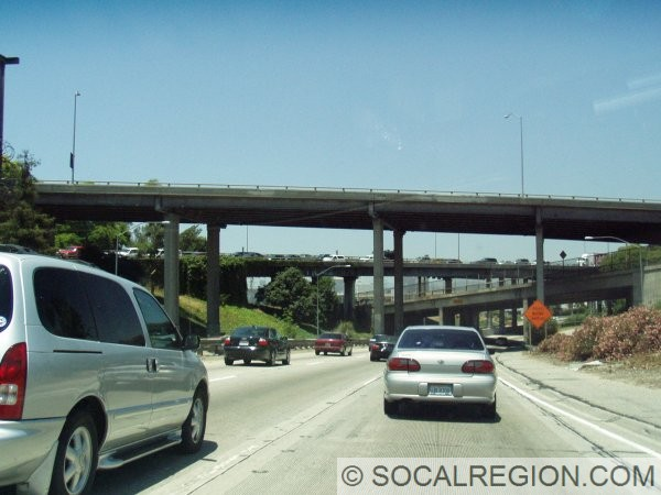 US 101 at its southern terminus looking north. The bridges in the background are the connectors to I-5 (Santa Ana southbound) and I-10 at the East Los Angeles Interchange. This section of US 101 was opened in 1947.