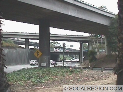 View from the onramp to 10 westbound from Soto Street. Ramp is in the foreground. Ramps from 10 eastbound are in the left background. Closest ramp connects I-5 southbound to the Santa Ana Freeway (I-5) southbound.