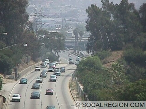 View of the 110s and 5s merge. The 110 SB is on the right side. The heavy traffic is from the I-5 connector.