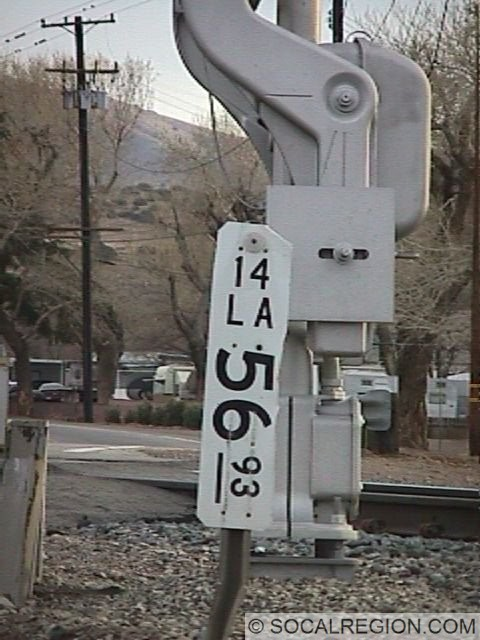 Sierra Highway crosses the railroad tracks just south of town. It stays on the east side of the tracks until just past Palmdale. Note the milepost for route 14.