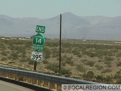 Sign marking the north end of SR-14. The distant mountains have been the site of many earthquake swarms in the past few years.