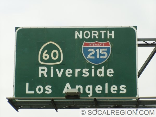 At the east 215 junction, both US 60 and US 395 are visible, note the shield outline behind the 215 shield. The 60 shield is covered by a larger panel.