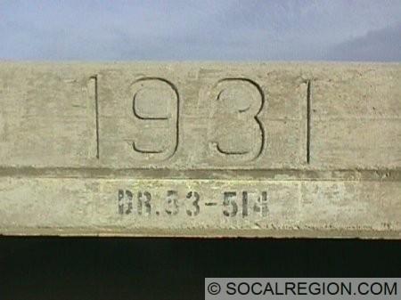 Close-up of culvert date stamp and bridge number.