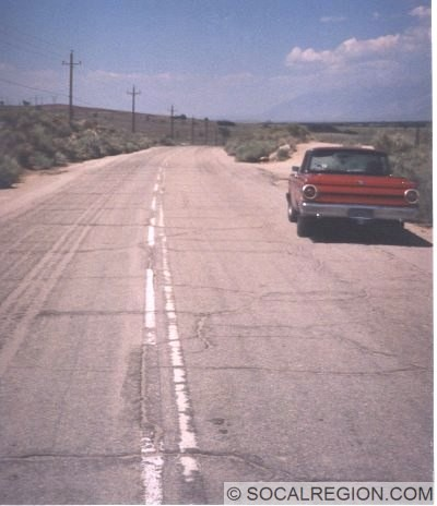 View of the 1950's road, with double white striping.