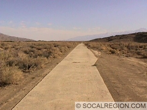 1916 8' wide concrete roadway with a pullout. This was the first paving in the Owens Valley and was probably done because of the muddy nature of this section of the Valley.