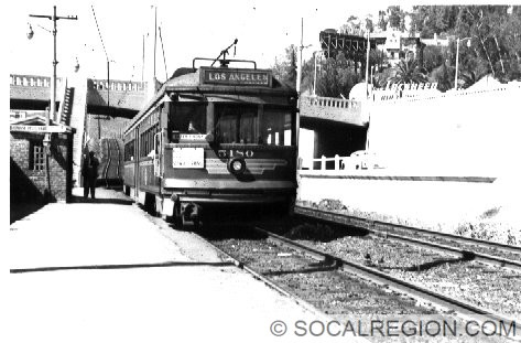 Pacific Electric car waiting at the Barham Blvd station in the median of US 101.