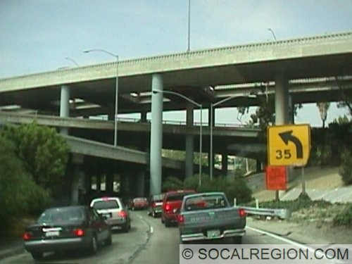 Connector to the 101 NB from the 110 NB. This ramp has had traffic like this since 1952. Also note the new concrete railing on the top of the Four Level Structure.