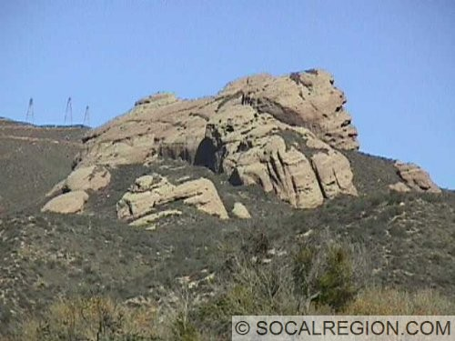 View of large rock outcroppings north of Soledad Canyon. They are composed of the Oligocene Vasquez Formation.
