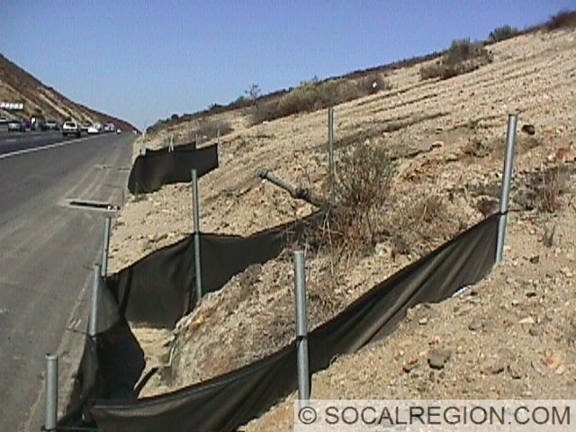 This photo was taken along SR-14 just south of the San Gabriel Fault near Golden Valley Road. This oil seep is natural and flows quite well. I include this in the Newhall section as it still lies within the Ventura Basin, an oil-rich sedimentary basin, while closer Canyon Country sits within the Soledad Basin, an oil-poor sedimentary basin.