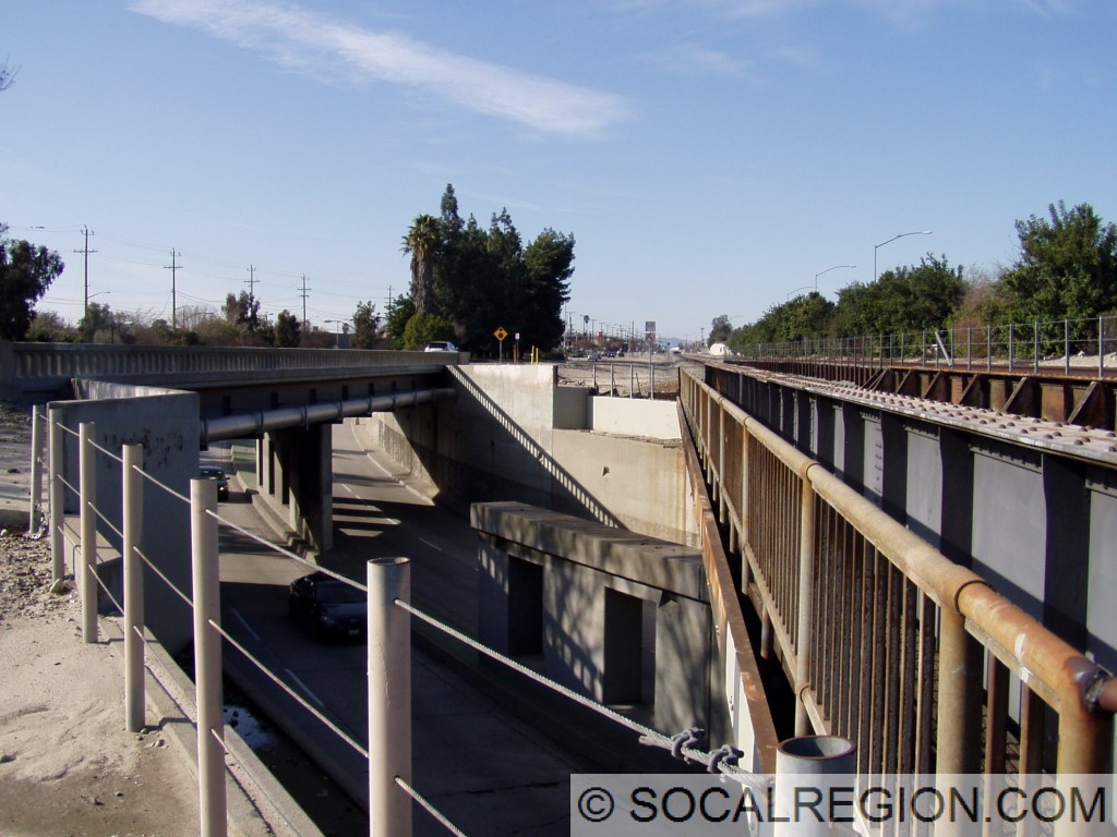 Northerly view of the railroad overpass and northbound Victory Place bridge. Supports were built for an additional track but not used.