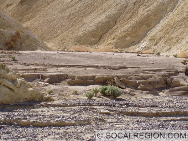 Here, the difference in post and pre-diversion sediments are more obvious. The larger clasts within the wash are post-diversion. On the left side of the side canyon, debris deposited during a high flood is visible.